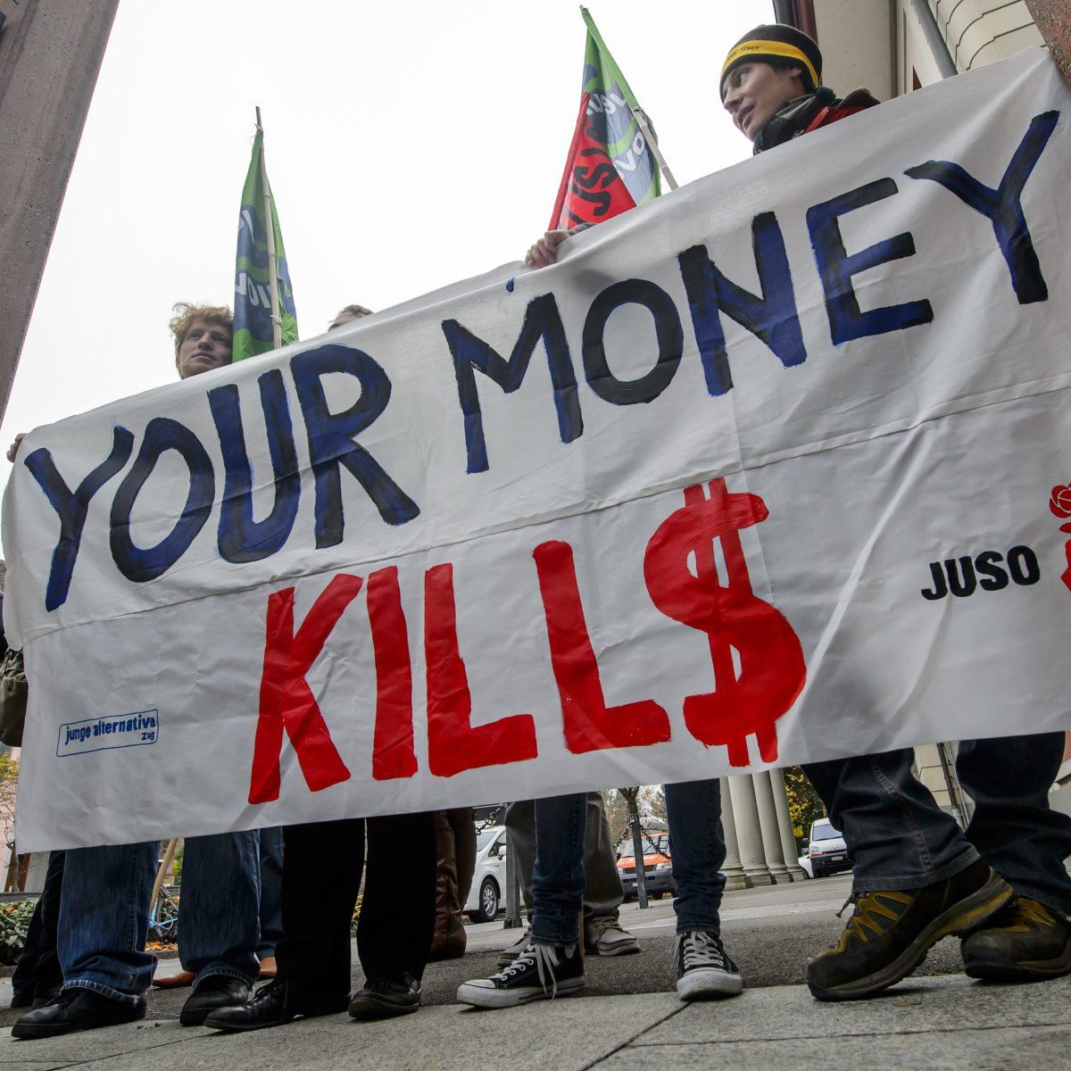 Manifestation en novembre 2012 à Zurich en Suisse contre la firme Glencore et Xstrata. © AFP PHOTO / FABRICE COFFRI