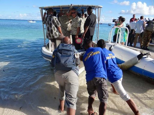 "Staff push a boat used to transport Pacific Islands Forum leaders from Eneko Island on September 5, 2013. A new Pacific regional pact calling for aggressive action to combat climate change has achieved a ""major accomplishment"" by gaining US support, officials said Sunday. © AFP/File Giff Johnson"