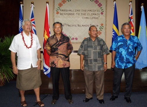 L-R: Secretary General of the Pacific Islands Forum Secretariat Tuiloma Neroni Slade, Cook Islands Prime Minister Henry Puna, Marshall Islands President Christopher Loeak and Tuvalu Prime Minister Enele Sopoaga are pictured at the opening of the 15-nation Pacific Islands Forum in Majuro on September 3, 2013. © AFP Giff Johnson