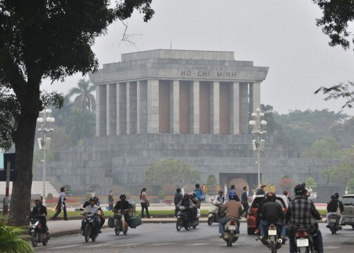 Motorcyclists ride past the mausoleum of late president Ho Chi Minh on February 24, 2010 in Hanoi. © AFP/File Hoang Dinh Nam