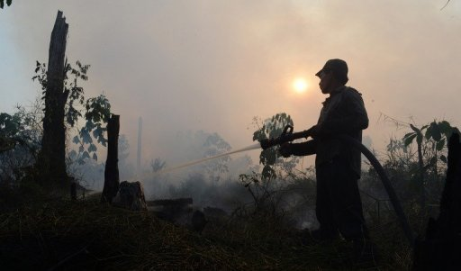 Indonesian farmers in a province at the centre of Southeast Asia's worst smog outbreak for years have filed a lawsuit against the president in response to the haze crisis, activists said Wednesday.