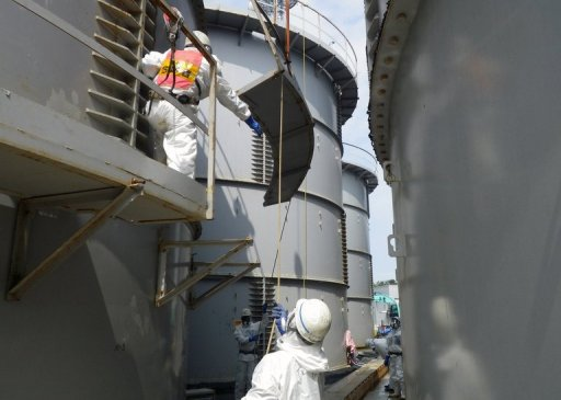 Workers prepare to take apart a contamination water tank at the Fukushima Dai-ichi nuclear plant in Okuma, Japan, in a photo by Tokyo Electric Power Co (TEPCO) on September 13, 2013. Japan's nuclear authority plans to conduct radiation contamination surveys at 600,000 points on the seabed off the crippled Fukushima nuclear plant, up from 200 places so far, a report said Saturday. © TEPCO/AFP Tepco