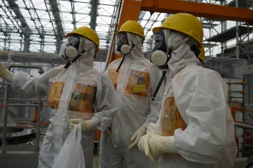 Workers inspect the Fukushima Dai-ichi nuclear power plant on September 12, 2013, in a photo taken by Tokyo Electric Power Co (TEPCO). Japanese Prime Minister Shinzo Abe Thursday ordered the operator of the crippled Fukushima nuclear plant to work out a schedule for stemming radioactive water leaks as he toured the facility. © TEPCO/AFP/File