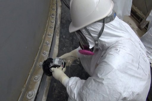 This handout picture taken by Tokyo Electric Power Co (TEPCO) on September 4, 2013 shows a TEPCO worker checking radiation around the contamination water tank at TEPCO's Fukushima Dai-ichi nuclear power plant at Okuma town in Fukushima prefecture. © TEPCO/AFP/File