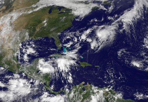 This NASA satellite image, released September 2013, shows Tropical Storm Gabrielle (Upper R) closing in on Bermuda. Forecasters said the storm, which was some 120 miles south of the island, was strengthening and approaching. © NASA/GOES Project?AFP