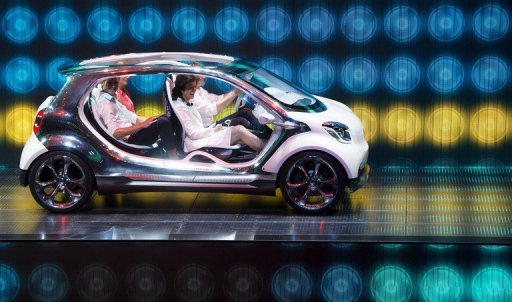 The new Smart four joy is presented at the Mercedes booth during the IAA automobile show in Frankfurt, on September 9, 2013. According to the organiser, more than 1,000 exhibitors from 35 countries will present their products. © AFP Johannes Eisele