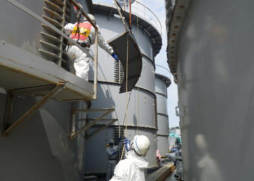 Des employés de Tepco travaillent sur le site de Fukushima, le 13 septembre 2013 à Okuma © Tepco/AFP/Archives