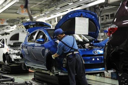 "Workers assemble the front bumper of Toyota's compact hybrid vechile ""AQUA"" on the assembly line of the Iwate plant on March 9, 2012 © AFP/File Toshifumi Kitamura"