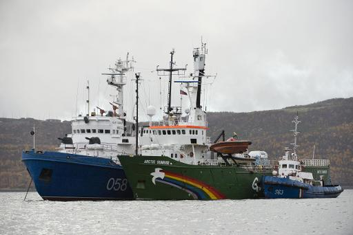 The Greenpeace vessel Arctic Sunrise (centre) is flanked by two Russian ships in Murmansk harbour, on September 28, 2013 © Greenpeace International/AFP/File Dmitri Sharomov