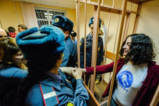 "A photo issued by Greenpeace on November 21, 2013 shows ""Arctic 30"" activist Gizem Akhan (R) from Turkey, in court in Saint Petersburg, Russia  © Greenpeace International/AFP Vladimir Baryshev"