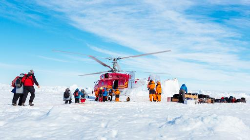 A helicopter from the Chinese icebreaker Xue Long picks up the first batch of passengers from the stranded Russian ship Akademik Shokalskiy as rescue operations take place after over a week of being trapped in the ice off Antarctica, January 2, 2014  © footloosefotography.com/AFP Andrew Peacock