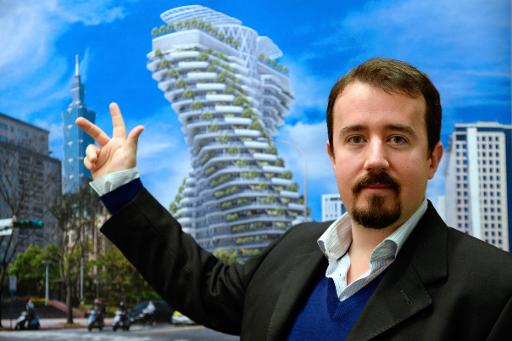 French architect Vincent Callebaut poses as he presents a picture of one of his futuristic projects on January 10, 2014 in Paris © AFP Bertrand Guay