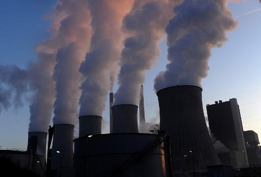 Cooling towers of E.ON's coal-fired power plant at Scholven in Gelsenkirchen, western Germany, on January 16, 2012 © AFP/File Patrik Stollarz