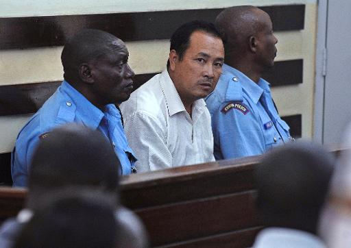 Tang Yong Jian (C), 40, a Chinese national, is arraigned in a Nairobi court January 27, 2014 after he was arrested for trying to smuggle 3.4 kg of raw elephant ivory through Kenya © AFP Tony Karumba