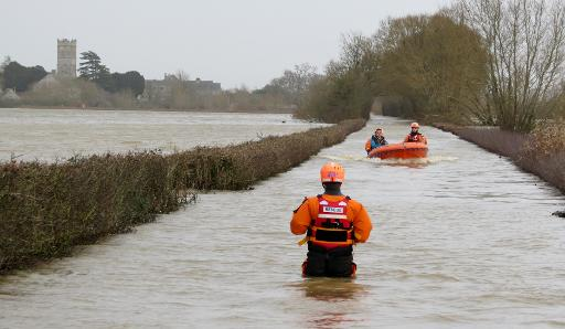 Rescuers carry out operations following flooding in Muchelney, Somerset on January 6, 2014 © Burnham Area Rescue Boat/AFP/File Ho