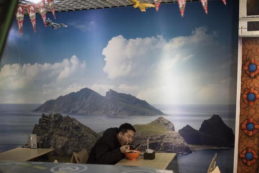 Un chinois mange dans un restaurant de Pékin, le 26 janvier 2015 © AFP/Archives Fred Dufour